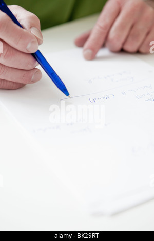 Writing on paper - Stock Photo