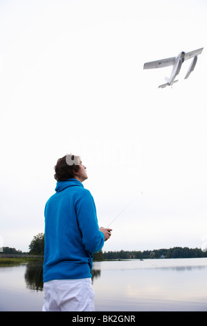 Man with a remote-controlled plane - Stock Photo