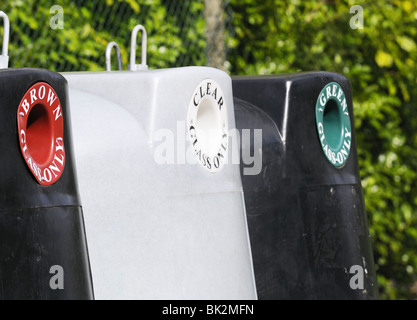 Communal recycling collection bins  in residential Reading for bottles (l to r  bins ,Brown  Clear, Green - Stock Photo