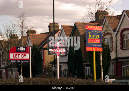 A row of for sale/ to Let  signs in Tottenham , North London England UK - Stock Photo