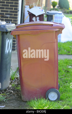 Domestic  rubbish 'wheelie  bins' waiting outside houses for refuse collectors, - Stock Photo