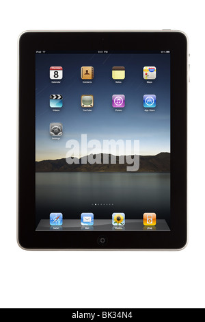An iPad tablet computer and its home screen with default install applications - Stock Photo