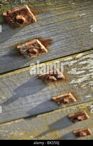 Rusty nuts, bolts and washers on a sea defence groyne in East Sussex, England. - Stock Photo