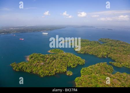 Container ships on Gatun Lake heading for Gatun Locks, Panama Canal, Panama, Central America - Stock Photo