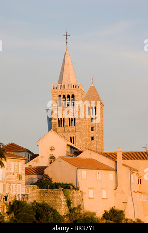 Late afternoon sunlight on the bell towers in Rab Town, Rab Island, Kvarner region, Croatia, Europe - Stock Photo