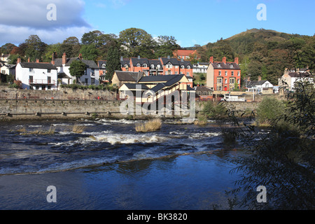 The river Dee and the railway station with the medieval castle of Dinas Bran on the hill in the background, Llangollen, - Stock Photo