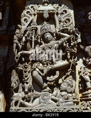 Close-up of the Hindu goddess Durga, detail of the Hoyasala temple at Halebid, Karnataka, India, Asia - Stock Photo