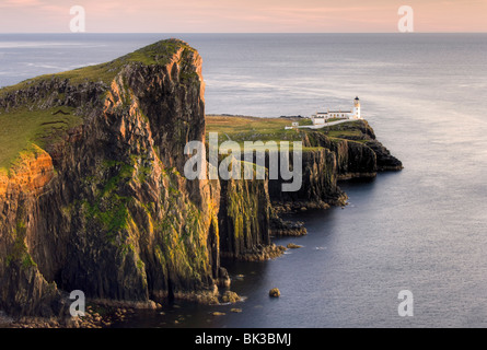 Neist Point and Lighthouse bathed in evening light, Isle of Skye, Highland, Scotland, United Kingdom, Europe - Stock Photo