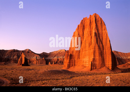 Pre-dawn light illuminates the Temple of the Sun and Temple of the Moon in upper Cathedral Valley in Capitol Reef - Stock Photo