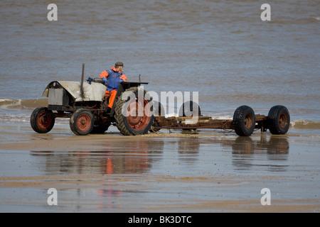 Tractor on beach - Stock Photo