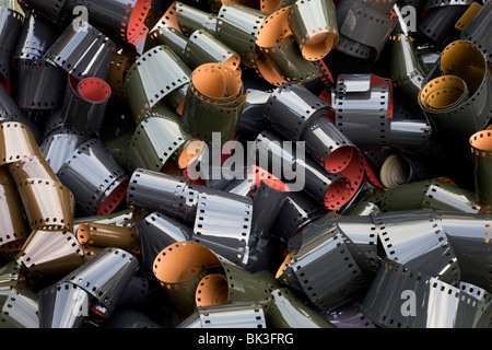 Coils of undeveloped, generic 35mm film emulsion, an antiquated analogue technology replaced by the digital camera - Stock Photo