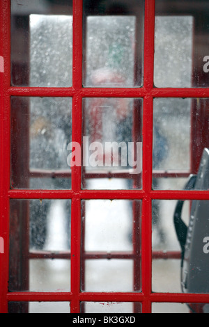 Detail of a Phone Box, Red, Westminster, London. - Stock Photo