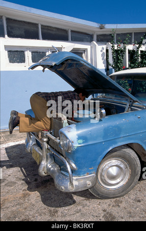 Car Mechanic in Candelaria, Cuba - Stock Photo