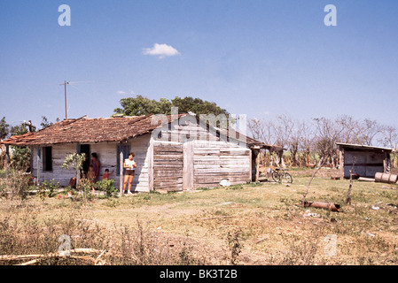 Rural home with a television antenna and a bicycle in the yard, in Pinar del Rio Province, Cuba - Stock Photo
