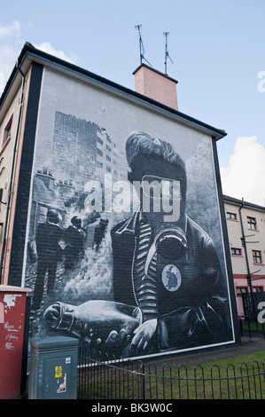 Mural of a boy wearing a gas mask and holding a lit petrol bomb within a riot following Bloody Sunday - Stock Photo