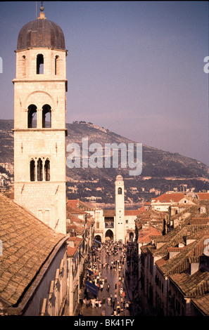 Bell tower and clock tower along the main street in Dubrovnik's Old Town, Croatia - Stock Photo