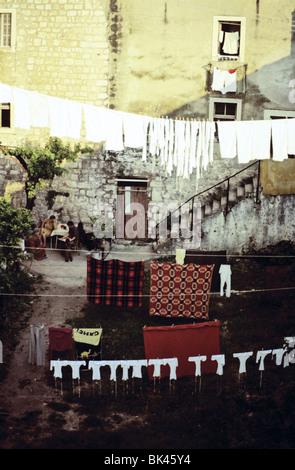Clothing drying on clotheslines, Croatia - Stock Photo