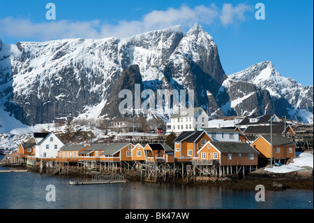 Traditional wooden Rorbu fishermen`s huts in village of Sakrisoy on Moskenesoya Island in Lofoten Islands in Norway - Stock Photo