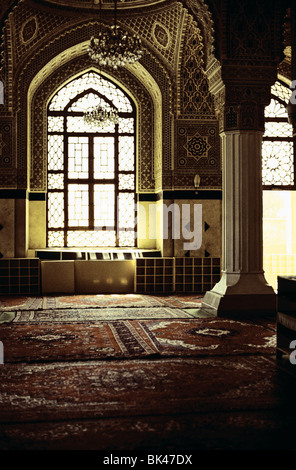 Interior of a mosque showing a decorative hallway with carpets in Baghdad, Iraq - Stock Photo