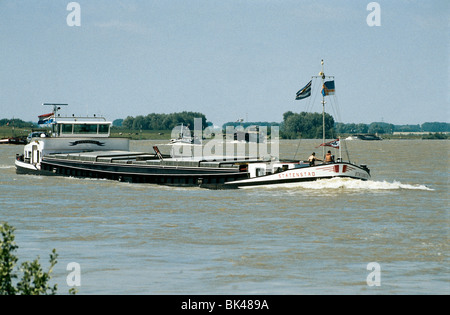 Inland motor freighter Statenstad leading a convoy of barges on the Rhine River near Xanten, Germany - Stock Photo