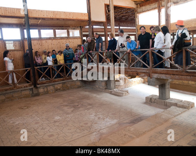 A tour group looking at the mosaics in the House of Dionysos at the Paphos Archaeological Park, Cyprus Europe - Stock Photo