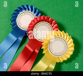 Blue, Red and Yellow Rosettes. Blank in the centre. - Stock Photo