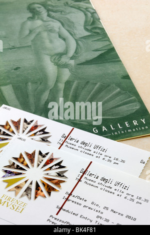 Two entrance tickets to Florence's most famous gallery, the Galleria degli Uffizi and a brief guide of the Uffizi - Stock Photo