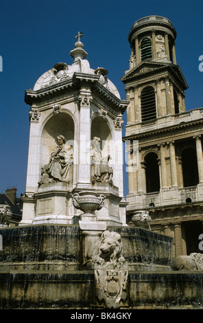 1844 fountain by Visconti displays sculpted likenesses of four bishops of Louis XIV era in front of church Saint - Stock Photo