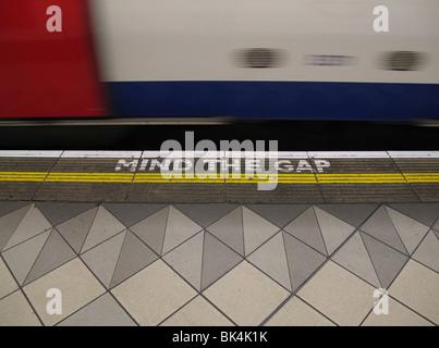 mind the gap written on platform at bank station on London underground - Stock Photo