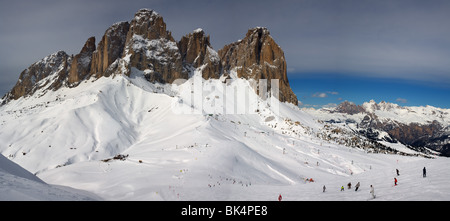 panoramic image of Dolomites mountains in winter, Italy, view of Sassolungo with Col Rodella ski area, Sella Ronda - Stock Photo