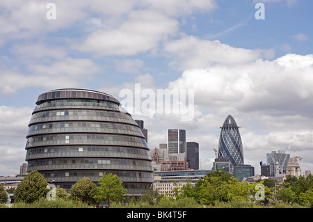 London Assembly building (City Hall) and city of London buildings, UK. - Stock Photo