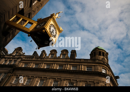 The Gold Venus Rolex Clock, on the Northern Goldsmiths shop, Grainger Town, Newcastle Upon Tyne. - Stock Photo
