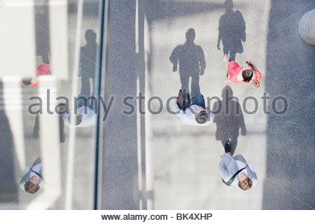 Shadows of people walking from directly above - Stock Photo