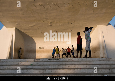 Children playing football in a monumental structure in centre town of Port au Prince Haiti - Stock Photo