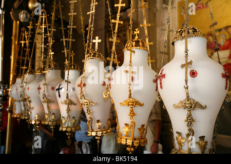 Lamps over the Stone of the Anointing, Church of the Holy Sepulchre, Jerusalem, Israel, Middle East - Stock Photo