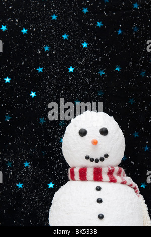 Snowman in the snow against starry night sky concept - Stock Photo
