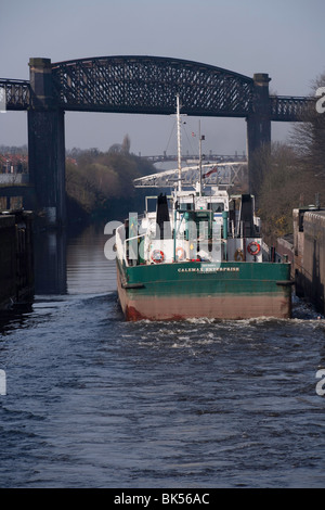Ship Calemax Enterprise leaving Latchford Locks on the Manchester Ship Canal - Stock Photo