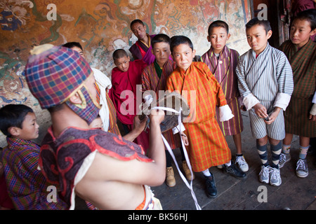 Buddhist monks celebrate at a traditional festival or Tsechu in Bhutan - Stock Photo