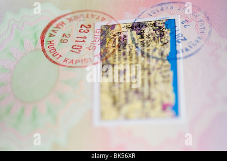 Turkish visa stamp stamps in a passport close-up - Stock Photo