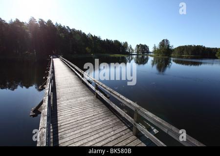 Wooden footbridge over Lake Puruvesi, Punkaharju Nature Reserve, Saimaa Lake District, Savonia, Finland, Scandinavia, - Stock Photo