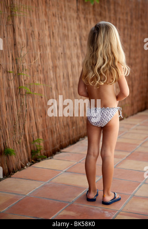 Blonde haired girl in bathing suit - Stock Photo