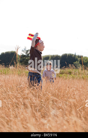 Young boys playing in field - Stock Photo