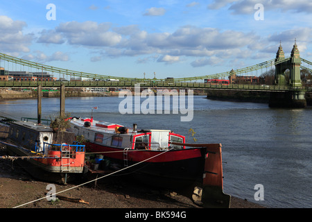 united kingdom west london hammersmith bridge with houseboats in foreground - Stock Photo