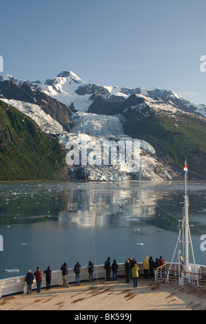 Passengers on cruise ship viewing the Vasser Glacier, College Fjord, Inside Passage, Alaska, United States of America - Stock Photo