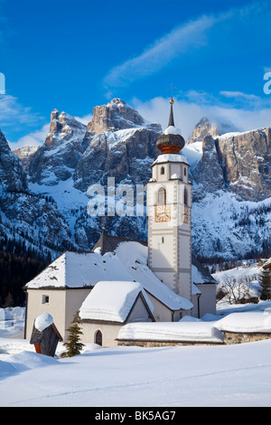 The church and village of Colfosco in Badia and Sella Massif range of mountains, South Tirol, Trentino-Alto Adige, - Stock Photo