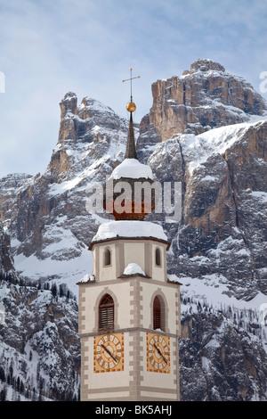 The church and village of Colfosco in Badia and Sella Massif range of mountains, South Tirol, Trentino-Alto Adige, - Stock Photo