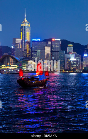 View from Kowloon of one of the last remaining Chinese sailing junks on Victoria Harbour, Hong Kong, China, Asia - Stock Photo
