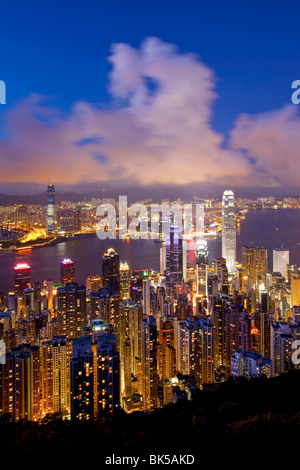 View over Hong Kong from Victoria Peak, the illuminated skyline of Central sits below The Peak, Victoria Peak, Hong - Stock Photo