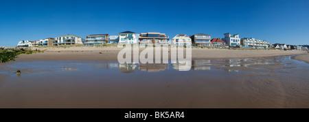 Row of houses overlooking the sea, Sandbanks, Poole, Dorset, England, United Kingdom, Europe - Stock Photo
