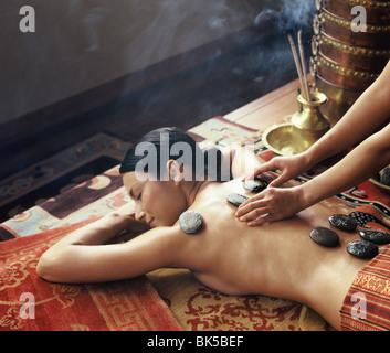 Tibetan hot stones treatment at Chi Spa, Shangrila, Bangkok, Thailand, Southeast Asia, Asia - Stock Photo